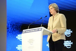 A Brexit balancing act: May heads to Davos